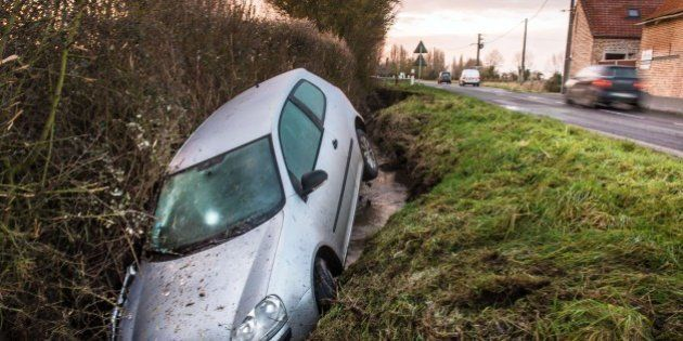 A car lies in a ditch following an accident in the northern French village of Meteren, on January 29,...