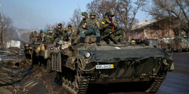 Ukraine: au moins 18 morts après les accords de paix de