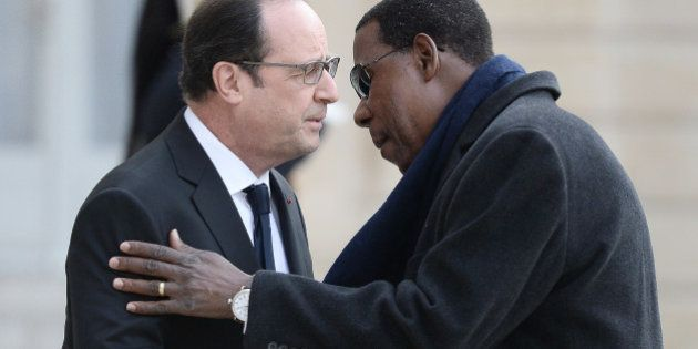 French President Francois Hollande welcomes Benin's President Thomas Boni Yayi upon his arrival at the...