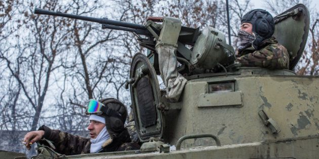ARTEMIVSK, UKRAINE - FEBRUARY 16: Ukrainian soldiers prepare to drive in the direction of the embattled...