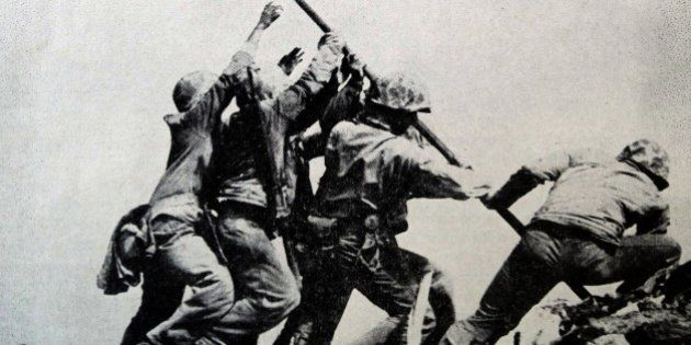 Raising the Flag on Iwo Jima is a historical photograph taken on February 23, 1945. It depicts five US...