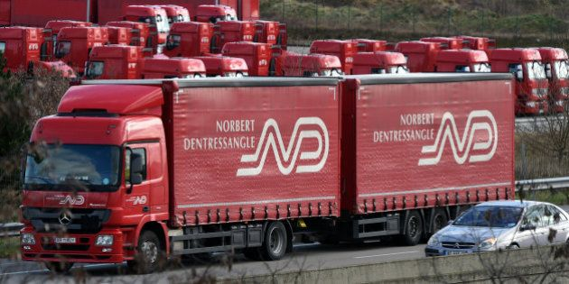 Transport: les camions rouges de Norbert Dentressangle roulent désormais sous pavillon