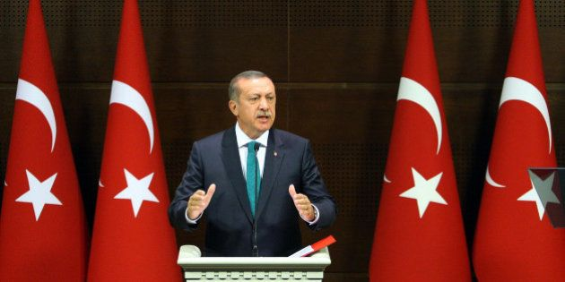 Turkish Prime Minister Recep Tayyip Erdogan addresses the media during a press conference in Ankara on...