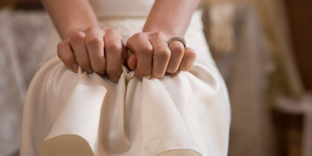 Woman clutching