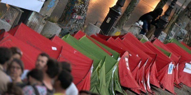 Homeless people helped by some 33 charity organizations set up tents along Saint-Martin canal to mark...