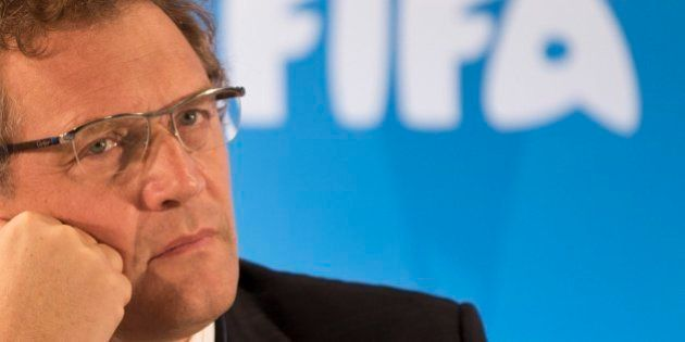 FILE - In this Thursday, Jan. 23, 2014 file photo FIFA Secretary General Jerome Valcke listen to questions...