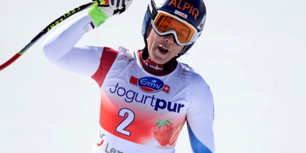 Switzerland's Fraenzi Aufdenblatten celebrates in the finish area after the women's downhill at the FIS...
