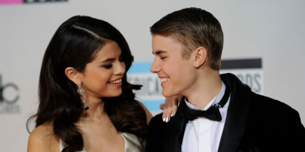 Selena Gomez, left, and Justin Bieber arrive at the 39th Annual American Music Awards on Sunday, Nov....
