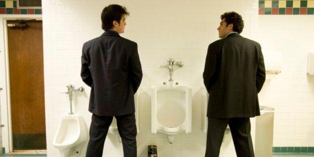 Businessmen using the bathroom