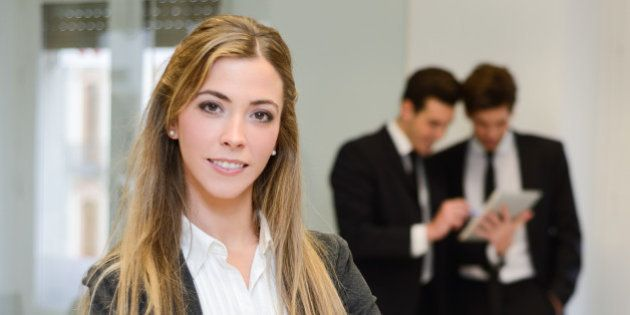 Image of businesswoman leader looking at camera in working