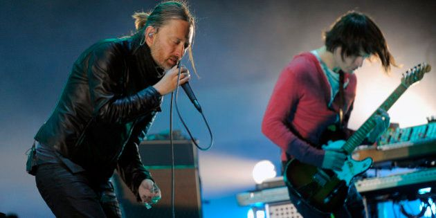 Thom Yorke, left, and Jonny Greenwood of Radiohead perform during the band's headlining set on the first...