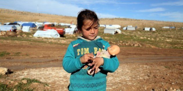MOSUL, IRAQ - MARCH 2: An Ezidi child holds her doll outskirts of Sinjar mountain, Mosul, on March 2,...