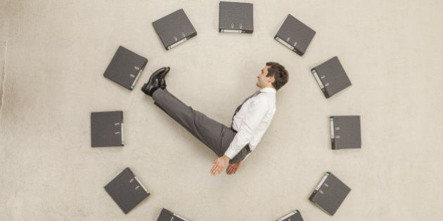 Businessman inside circle of files forming
