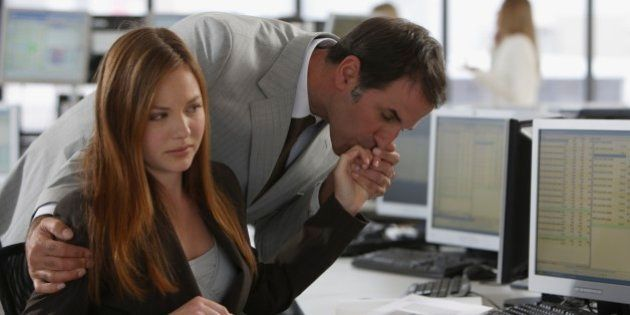 Businessman kissing businesswoman's hand
