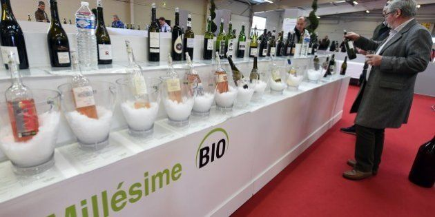 People visit a stand of the 'Millesime Bio 2016', an international organic wine fair, on January 26, 2016 in Montpellier. The event aims at promoting wines made from organically grown grapes and features new vintages for buyers. / AFP / PASCAL GUYOT        (Photo credit should read PASCAL GUYOT/AFP/Getty Images)
