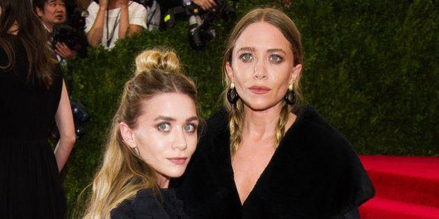 Mary Kate Olsen, left, and Ashley Olsen arrive at The Metropolitan Museum of Art's Costume Institute...