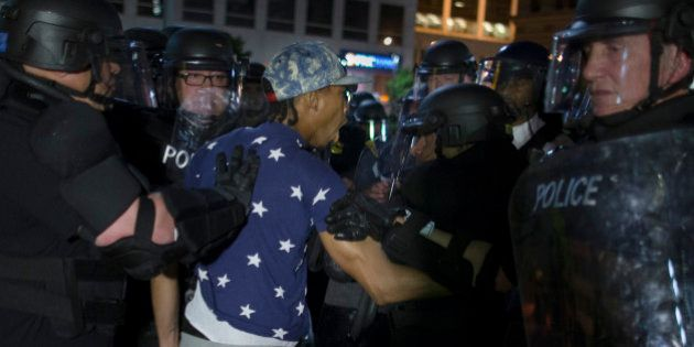 A demonstrator is arrested during a march against the acquittal of Michael Brelo, a patrolman charged...