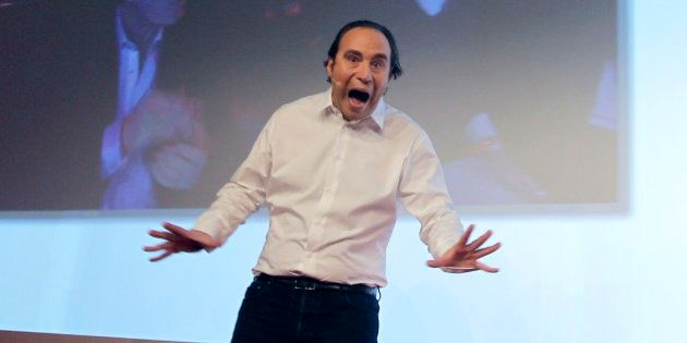 Xavier Niel , the French internet billionaire and founder of the Internet provider Free, reacts after...