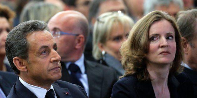 Former French President Nicolas Sarkozy, center, his wife, Carla Bruni-Sarkozy, left, and Nathalie Kosciusko-Morizet,...