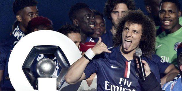 Paris Saint-Germain's Brazilian defender David Luiz reactson the podium after winning the French L1 title...