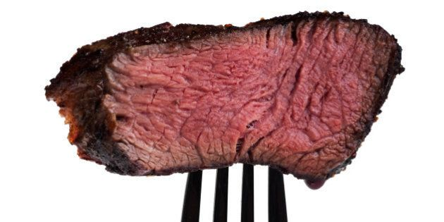 piece of a grilled steak on a...