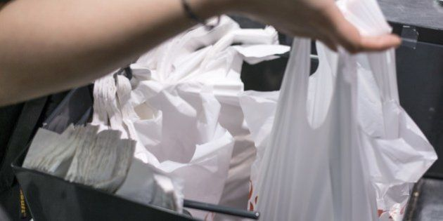 A person holds a plastic bag on June 30, 2014 in a supermarket in Paris. A governmental amendment added...