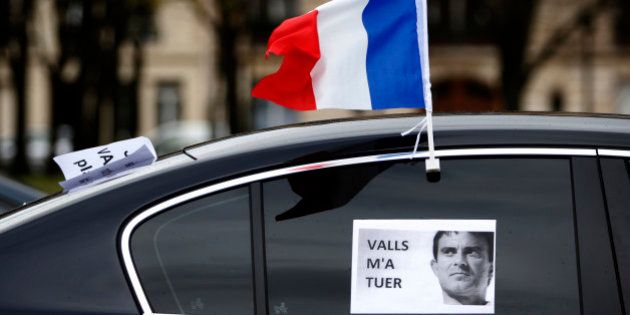 A French flag flies from a car during a demonstration by LOTI transport drivers (public transport on...