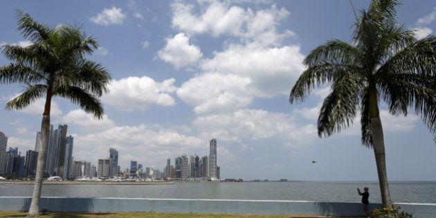 A man takes pictures on the seafront of Panama City, April 4, 2016. REUTERS/Carlos