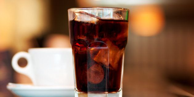 a glass of cola or soda with...