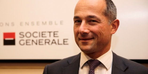 French bank Societe Generale Chairman and Chief Executive Officer Frederic Oudea poses after the company's...