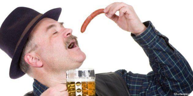 elderly man holding a beer...