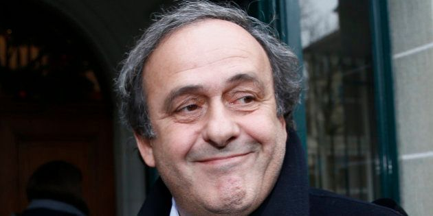 UEFA President Michel Platini smiles as he arrives for a hearing at the Court of Arbitration for Sport...