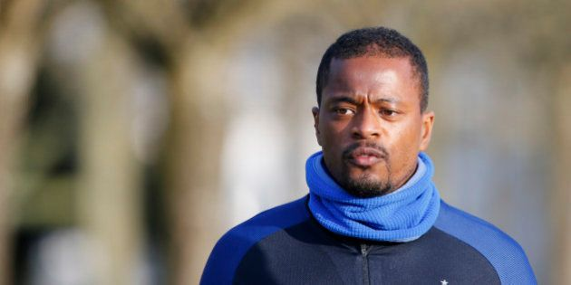 France's national soccer team player Patrice Evra arrives to attend a training session at the team training...