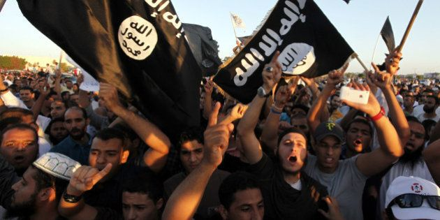 FILE - In this Friday, Sept. 21, 2012 file photo, Libyan followers of Ansar al-Shariah Brigades and other...