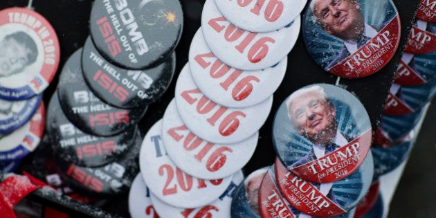 Snow collects on buttons for sale outside a campaign event for Republican presidential candidate Donald...