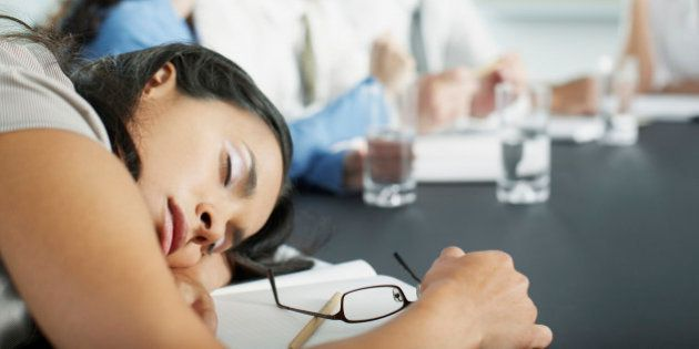 Businesswoman sleeping in conference room during