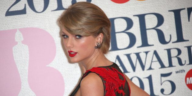 Taylor Swift poses for photographers upon arrival at the Brit Awards 2015 at the 02 Arena in London,...