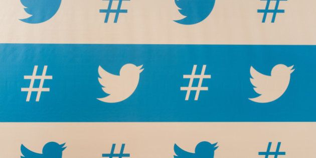 TO GO WITH AFP STORY BY NATALIA RAMOS Twitter's brand marks are seen as background of the speakers during...