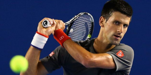 MELBOURNE, AUSTRALIA - JANUARY 13: Novak Djokovic of Serbia plays a backhand during a practice session...