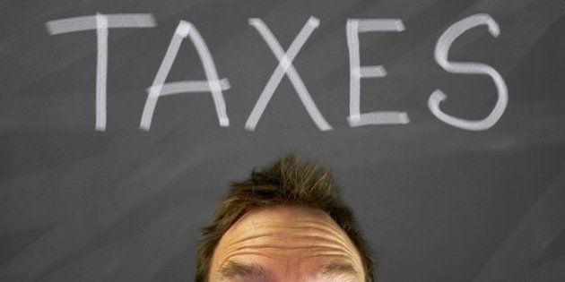 mans head with a taxes