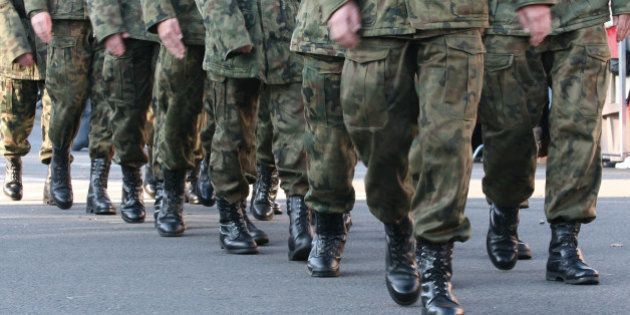 soldiers march in