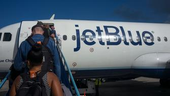 ST. GEORGE'S, GRENADA - FEBRUARY 13: Passengers departing on a JetBlue Airways flight to New York walk up a ramp February 13, 2018 at the Maurice Bishop International Airport in St. George's, Grenada. (Photo by Robert Nickelsberg/Getty Images)