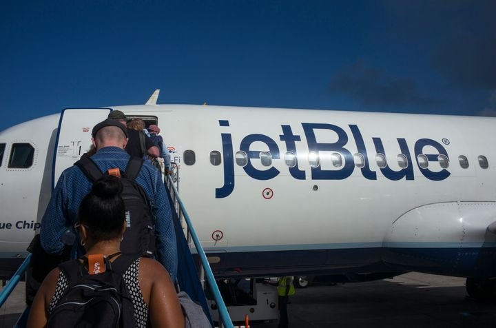 Passengers board a JetBlue flight.