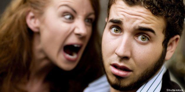 young woman yells at man with...