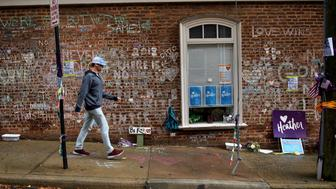 TOPSHOT - A man walks past a memorial to Heather Heyer and the other victims of last year's hit and run a few blocks away the first day of jury selection for James Fields's murder trial at the Charlottesville Circuit Court, November 26, 2018 in Charlottesville, Virginia. - An American neo-Nazi denied murder at the start of his trial for allegedly ramming his car into counter-protesters at a 2017 white supremacist rally that made the city of Charlottesville a byword for rising racial tensions under President Donald Trump. (Photo by Brendan Smialowski / AFP)        (Photo credit should read BRENDAN SMIALOWSKI/AFP/Getty Images)