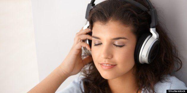 attractive schoolgirl listening ...
