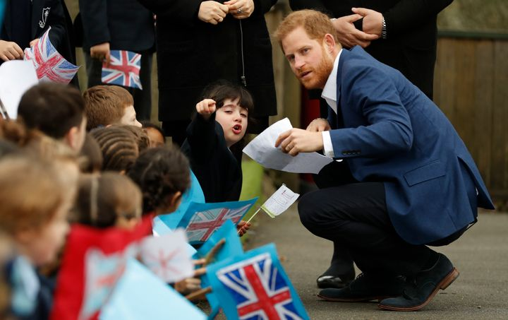 The Duke of Sussex speaks to 6-year-old Stella, a pupil at St. Vincent's Catholic Primary School.