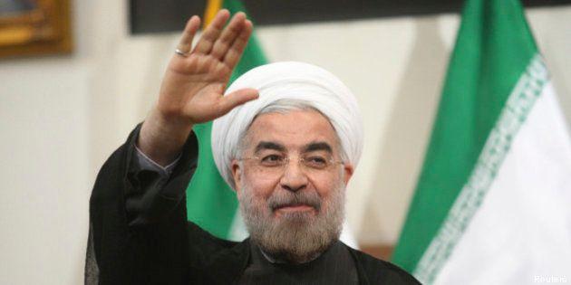 Iran: Rohani a pris ses fonctions officielles de président et veut oeuvrer pour lever les