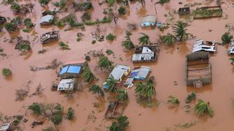 TOPSHOT - A picture shows houses in a flooded area of Buzi, central Mozambique, on March 20, 2019, after the passage of cyclone Idai. - International aid agencies raced on March 20 to rescue survivors and meet spiralling humanitarian needs in three impoverished countries battered by one of the worst storms to hit southern Africa in decades. Five days after tropical cyclone Idai cut a swathe through Mozambique, Zimbabwe and Malawi, the confirmed death toll stood at more than 300 and hundreds of thousands of lives were at risk, officials said. (Photo by ADRIEN BARBIER / AFP)        (Photo credit should read ADRIEN BARBIER/AFP/Getty Images)