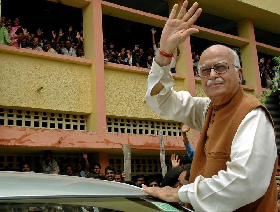 L.K. Advani waves as he comes out of a district court in Rae Bareli on July 28,